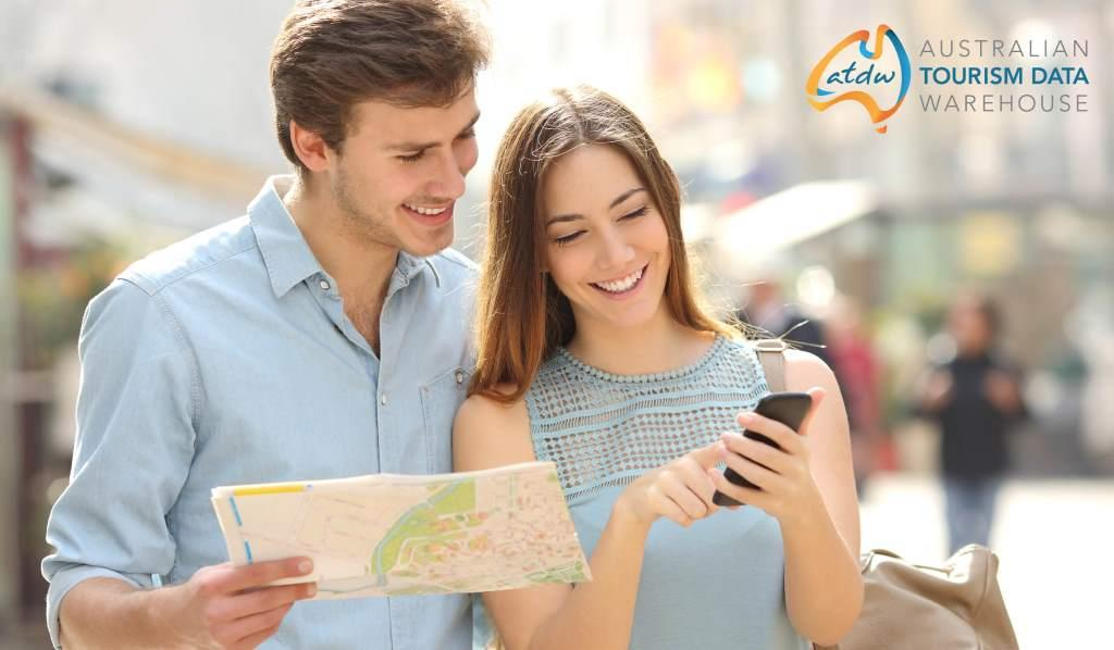 ATDW couple using map and phone
