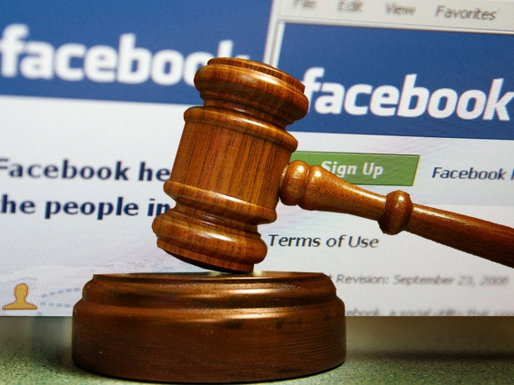 gavel in front of Facebook background