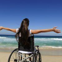 girl in wheelchair on beach